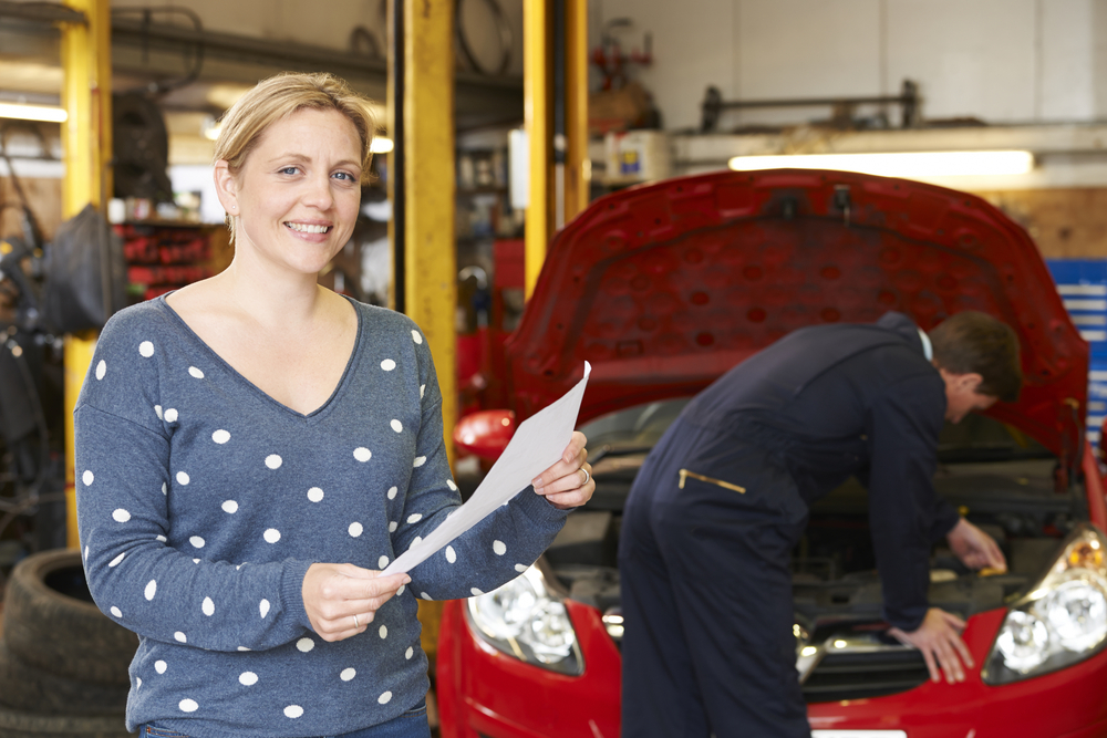 Women happy with car servicing and maintenance promotion.