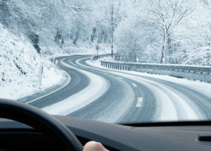 Driving safely on roads in snowy and icy conditions.